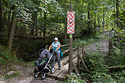 A mother pushes her child's buggy on a footpath in the Tatra National Park, on 16th September 2019, near Koscielisko, Zakopane, Malopolska, Poland.