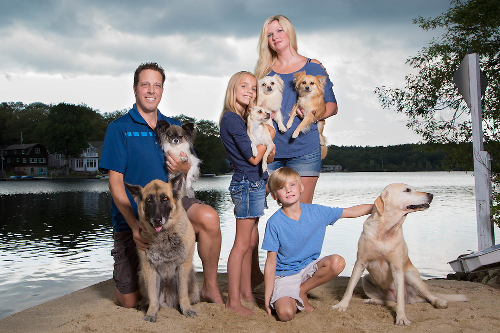 Family photo on the lake that is now a canvas print hanging in their home