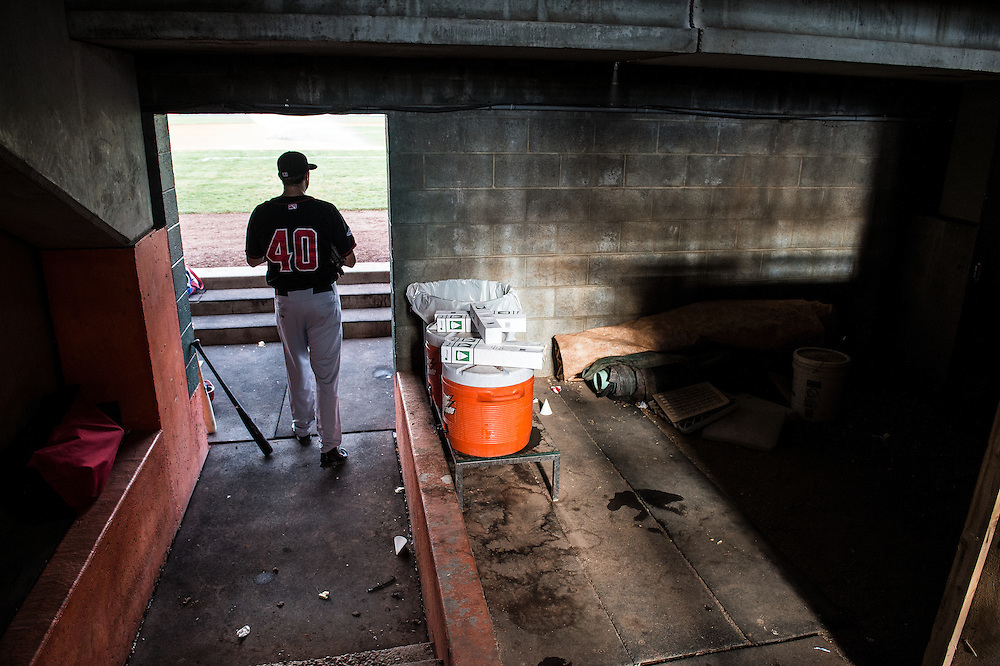 The Vancouver Canadians,Tim Mayza, walks into the dug-out before a game  vs. the Boise Hawks in Boise, Idaho.