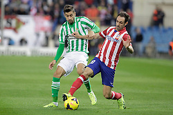 27.10.2013, Estadio Vicente Calderon, Madrid, ESP, Primera Division, Atletico Madrid vs Real Betis, 10. Runde, im Bild Atletico de Madrid's Juanfran (R) and Real Betis Vadillo // Atletico de Madrid's Juanfran (R) and Real Betis Vadillo during the Spanish Primera Division 10th round match between Club Atletico de Madrid and Real Betis at the Estadio Vicente Calderon in Madrid, Spain on 2013/10/28. EXPA Pictures © 2013, PhotoCredit: EXPA/ Alterphotos/ Victor Blanco<br /> <br /> *****ATTENTION - OUT of ESP, SUI*****