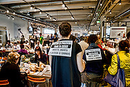 Roma  1 Maggio 2014<br /> Festa del Lavoro: Manifestazione dei movimenti ad Eataly contro lavoro precario e jobs act. Volantini  all'interno di Eataly contro il lavoro precario ed il jobs act.<br /> Rome May 1, 2014 <br /> Labor Day: Manifestation of radical movements at Eataly against precarious work and jobs act. Flyers within Eataly against precarious work and the jobs act.