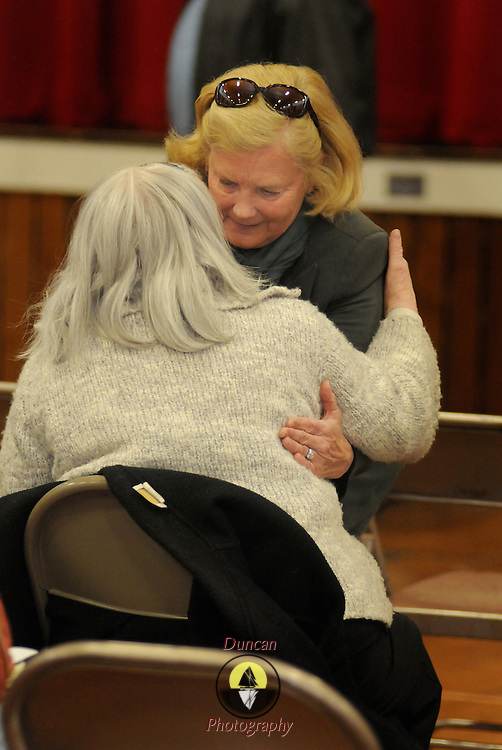 "2/26/12 -- BRUNSWICK, Maine. U.S. Congresswoman Chellie Pingree visits with a friend after speaking to the sparsely attended Democratic Caucus on Sunday afternoon at Brunswick Middle School. She said, ""I know that you are busy people.  But - you're here because you care. If you each can bring 10 people to the polls to reelect President Obama we will have a shot at slowing down the conservative agenda."" She added that she didn't like the Republican alternatives to Obama and that local Democratic legislators needed support as well. Photo by Roger S. Duncan."