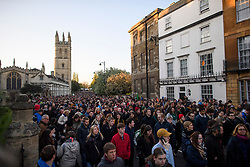 © Licensed to London News Pictures. 01/05/2018. Oxford, UK. Oxford University students and members of the public celebrate May Day in the early hours of the morning near Magdalen Bridge in Oxford, Oxfordshire. Students were again prevented from jumping from Magdalen Bridge in to the river, which has historically been a tradition, due to injuries at a previous years event . Photo credit: Ben Cawthra/LNP