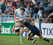 Racing 92 player XAVIER CHAUVEAU fights a tackle from Highlanders player JOSH RENTON during the Natixis Cup rugby match between French team Racing 92 and New Zealand team Otago Highlanders at Sui San Wan Stadium in Hong Kong.