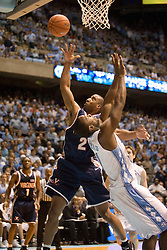 Virginia's J.R. Reynolds (2) shoots a lay up over North Carolina's Marcus Ginyard (1).   The top ranked Tar Heels beat the Cavaliers 79-69 to improved to 15-1 overall, 2-0 ACC on January 10, 2007 at the Dean Smith Center in Chapel Hill, NC.<br />