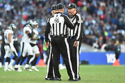 The game officials chat during a time out during the International Series match between Jacksonville Jaguars and Philadelphia Eagles at Wembley Stadium, London, England on 28 October 2018.