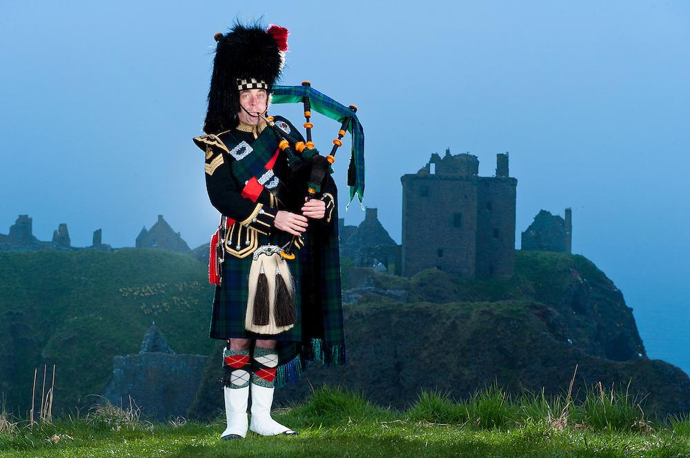 Skirlie McPiper at Dunnotar Castle, Scotland