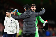 Liverpool manager Jurgen Klopp celebrates the 3-0 win with Alisson Becker (1) of Liverpool at full time during the Premier League match between Bournemouth and Liverpool at the Vitality Stadium, Bournemouth, England on 7 December 2019.