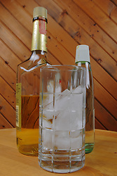 """Food and Drink industry: alcohol, hard liquor chilled """"on the rocks"""" or over ice in a clear glass tumbler."""