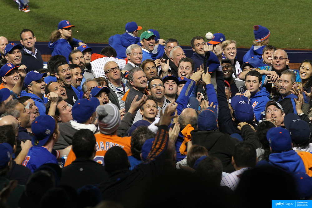 Fans jostle for a ball thrown into the crowd during the New York Mets Vs Kansas City Royals, Game 5 of the MLB World Series at Citi Field, Queens, New York. USA. 1st November 2015. Photo Tim Clayton