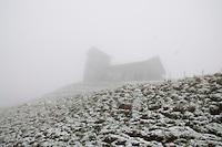 Mt. Rigi, Central Switzerland. View of an old church on a Rigi hillside through the fog.