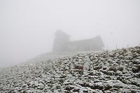 Mt. Rigi, Central Switzerland. View of an old church on a Rigi hillside through the fog.