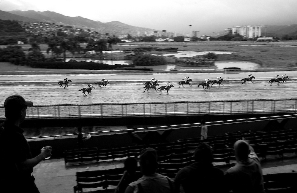 In this photo taken Nov. 28, 2010, fans watch a horse race during the Caribbean Classic Series at the Rinconada racetrack in Caracas, Venezuela