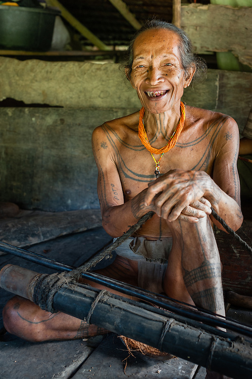Mentawai indigenous old man with arrows.