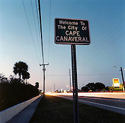NASA Space Junk Auction.Cape Canaveral sign post, Merritt Island.The entry sign to the City of Capa Canaveral, once known as Cape Kennedy, the home to NASA and America's manned-space race. The sign declaring Capa Canaveral on Merritt Island, Florida. Here for 40 years the US space programme has been sending men, chimps and missiles into space. Merritt Island is also home to the space junk auction, alot of the NASA workforce and also the Kennedy Space Center. This is known as the Space Coast.