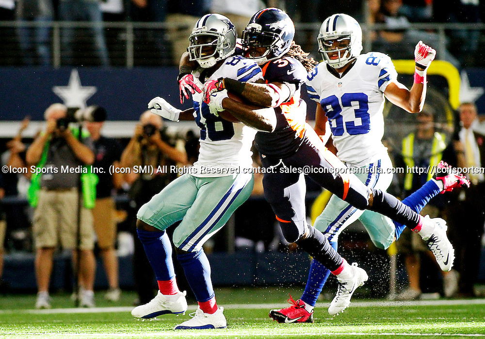 06 OCTOBER 2013: Dallas Cowboys wide receiver Dez Bryant (88) is tackled by Denver Broncos cornerback Omar Bolden (31)  during a regular season NFL football game between the Denver Broncos and Dallas Cowboys at AT&T Stadium in Arlington, TX. Denver won 51-48.