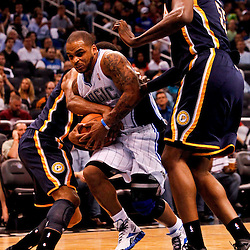 March 11, 2012; Orlando, FL, USA; Orlando Magic point guard Jameer Nelson (14) and Indiana Pacers small forward Danny Granger (33) battle for possession as center Roy Hibbert (55) defends during the second quarter of a game at  Amway Center.   Mandatory Credit: Derick E. Hingle-US PRESSWIRE
