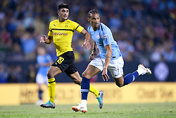 July 20, 2018 - Chicago, IL, U.S. - CHICAGO, IL - JULY 20: Manchester City forward Leroy Sane (19) and Borussia Dortmund midfielder Mahmoud Dahoud (19) battle during an International Champions Cup match between Manchester City and Borussia Dortmund on July 20, 2018 at Soldier Field in Chicago, Illinois. (Photo by Robin Alam/Icon Sportswire) (Credit Image: © Robin Alam/Icon SMI via ZUMA Press)