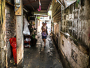 15 FEBRUARY 2015 - BANGKOK, THAILAND:  A narrow soi (alley) near the Kudeejeen neighborhood in Bangkok.      PHOTO BY JACK KURTZ