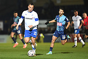 Tranmere Rovers defender (on loan from West Bromwich Albion) Kane Wilson (22) under pressure from Wycombe Wanderers striker Scott Kashket (11) during the The FA Cup match between Wycombe Wanderers and Tranmere Rovers at Adams Park, High Wycombe, England on 20 November 2019.