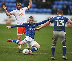 Jack Byrne of Oldham Athletic (C) has a shot at goal - Mandatory by-line: Jack Phillips/JMP - 02/04/2018 - FOOTBALL - Sportsdirect.com Park - Oldham, England - Oldham Athletic v Blackpool - Football League One