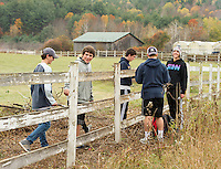 Daegan Blucher, Hunter Bean, Connor Guest, Ben Gardener and Sam Sawyer scape the fence at the Meadows Field in preparation for a new coat of paint during the Gilford/Gilmanton Community Service Day on Tuesday.  (Karen Bobotas/for the Laconia Daily Sun)