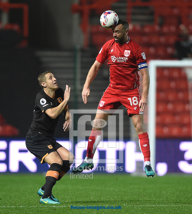 Hull City's Michael Dawson and Aaron Wilbraham of Bristol City during the EFL Cup match at Ashton Gate, Bristol<br /> Picture by Daniel Hambury/Focus Images Ltd +44 7813 022858<br /> 25/10/2016