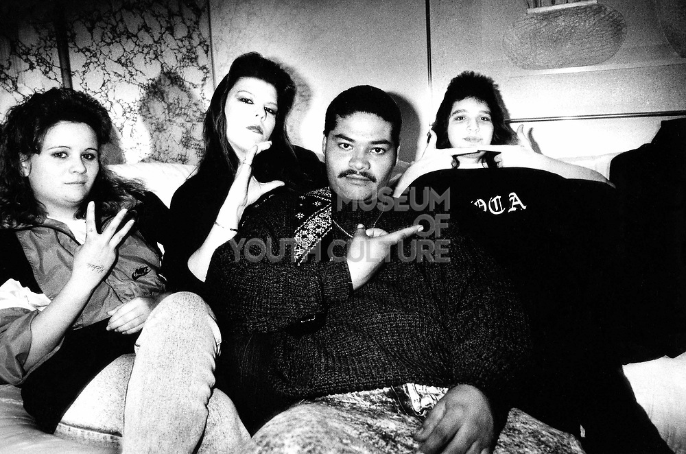 Gang group of 3 women and a guy sitting on a sofa, Los Angeles, USA, 1980's