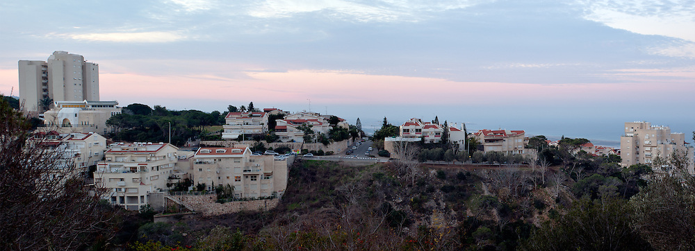 Panoramic view of houses and apartment buildings on Haifa's Mount Carmel at dawn with the Mediterranean coast in the background. WATERMARKS WILL NOT APPEAR ON PRINTS OR LICENSED IMAGES.