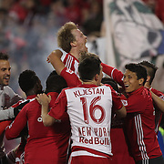 HARRISON, NEW JERSEY- APRIL 24: Dax McCarty, (top),  #11 of New York Red Bulls, celebrates with teammates after Bradley Wright-Phillips #99 of New York Red Bulls, second goal during the New York Red Bulls Vs Orlando City MLS regular season match at Red Bull Arena, Harrison, New Jersey on April 24, 2016 in New York City. (Photo by Tim Clayton/Corbis via Getty Images)
