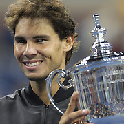 Rafael Nadal, Spain, with the trophy after beating Novak Djokovic, Serbia, during the Men's Singles Final at the US Open, Flushing. New York, USA. 9th September 2013. Photo Tim Clayton