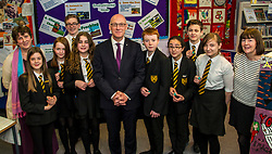 Pictured: John Swinney handed out Student Helper badges to studnet who help colleagues who have reading issues<br /> Education Secretary  John Swinney visited Grangemouth High School library today to launch the second round of bidding for a national funding programme aimed at improving school library services. <br /> <br /> <br /> Ger Harley | EEm 16 April 2018
