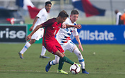 Team USA midfielder Evan Rotundo (10) and Portugal midfielder Diogo Prioste (8) fight for possession of the ball during a CONCACAF boys under-15 championship soccer game, Saturday, August 10, 2019, in Bradenton, Fla. Portugal defeated Team USA 3-0 and advanced to the finals against Slovenia. (Kim Hukari/Image of Sport)