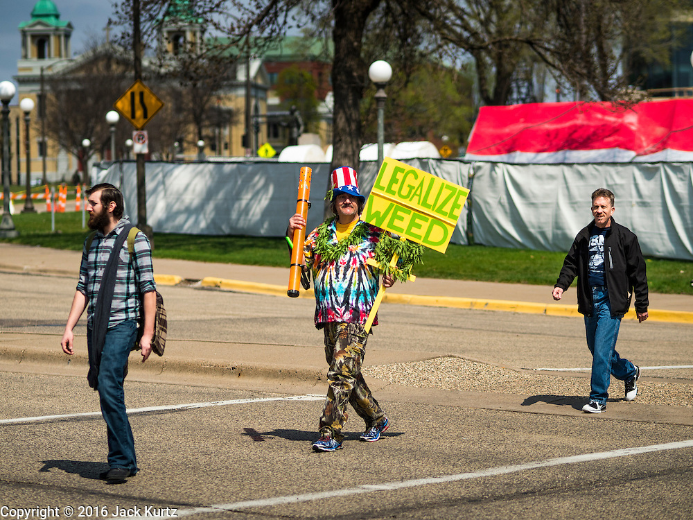"""20 APRIL 2016 - ST. PAUL, MN: A man who identified himself as """"Cool Breeze"""" walks to a marijuana legalization rally in St. Paul. About 100 people gathered at the Minnesota State Capitol in St. Paul and marched through downtown St. Paul calling for the decriminalization of marijuana. April 20 (4/20) has become a sort of counter culture holiday in the US, with marches in many cities calling for the legalization of marijuana.      PHOTO BY JACK KURTZ"""