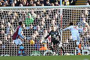 Liverpool forward Daniel Sturridge scores during the Barclays Premier League match between Aston Villa and Liverpool at Villa Park, Birmingham, England on 14 February 2016. Photo by Simon Davies.