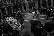 Police use pepper spray against the protestors during a demonstration after the inauguration of President Donald Trump, Friday, Jan. 20, 2017, in Washington. Protesters registered their rage against the new president Friday in a chaotic confrontation with police who used pepper spray and stun grenades in a melee just blocks from Donald Trump's inaugural parade route. Scores were arrested for trashing property and attacking officers.