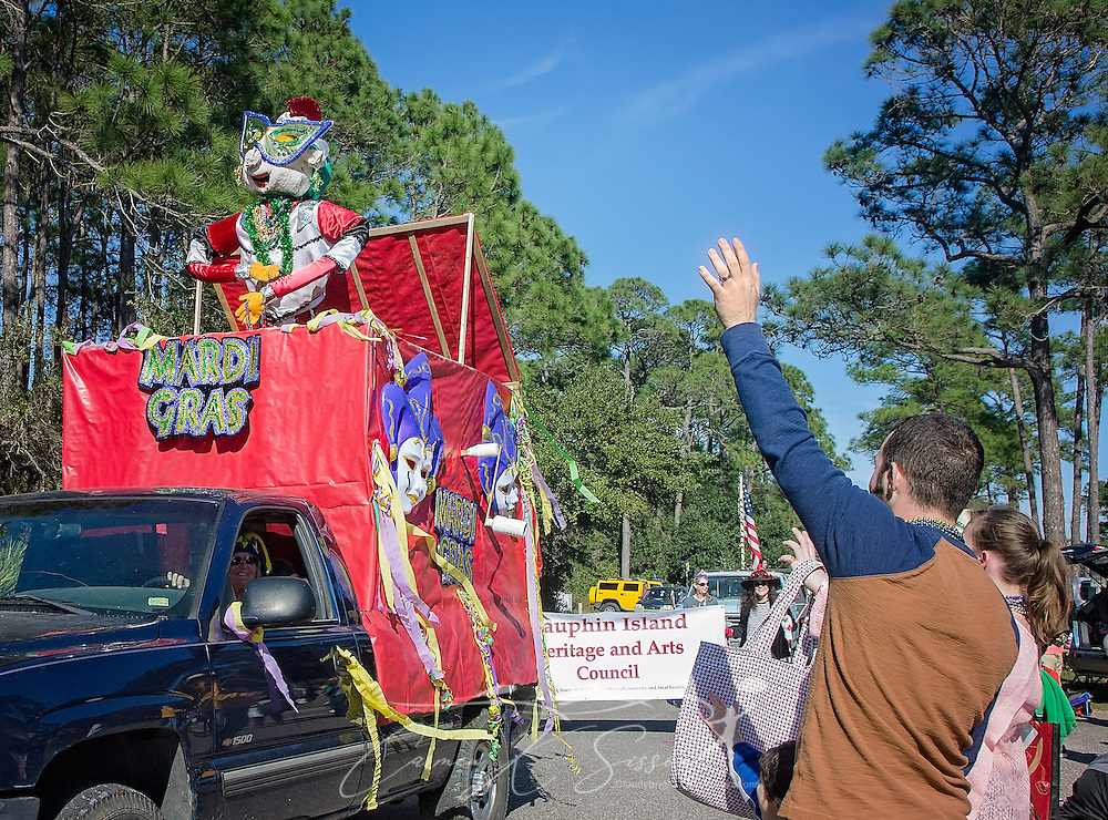 The crowd waves as a decorated float passes in Dauphin Island's first People's Parade during Mardi Gras, Feb. 4, 2017, in Dauphin Island, Alabama. French settlers held the first Mardi Gras in 1703, making Mobile's celebration the oldest Mardi Gras in the United States. The first parade of the season is traditionally held on Dauphin Island and draws thousands. (Photo by Carmen K. Sisson/Cloudybright)