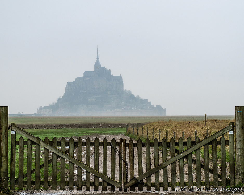 A distant foggy view of Le Mont St. Michel.<br /> <br /> Available Sizes: 8x10, 12x15, 16x20