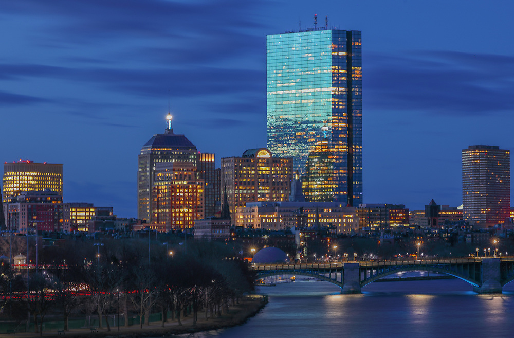 Boston photography showing familiar landmark along the Charles River, such as the 200 Clarendon better known as the John Hancock Tower with the newly renovated Longfellow Bridge. <br /> <br /> Boston skyline photos are available as museum quality photography prints, canvas prints, acrylic prints or metal prints. Fine art prints may be framed and matted to the individual liking and decorating needs:<br />  <br /> https://juergen-roth.pixels.com/featured/200-clarendon-with-longfellow-bridge-juergen-roth.html<br /> <br /> Good light and happy photo making!<br /> <br /> My best,<br /> <br /> Juergen<br /> Prints: http://www.rothgalleries.com<br /> Photo Blog: http://whereintheworldisjuergen.blogspot.com<br /> Instagram: https://www.instagram.com/rothgalleries<br /> Twitter: https://twitter.com/naturefineart<br /> Facebook: https://www.facebook.com/naturefineart