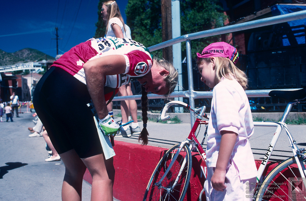 Cyclist signs an autograph for a fan, La Vuelta de Bisbee, Bisbee, Arizona.©1988 Edward McCain. All rights reserved. McCain Photography, McCain Creative, Inc.