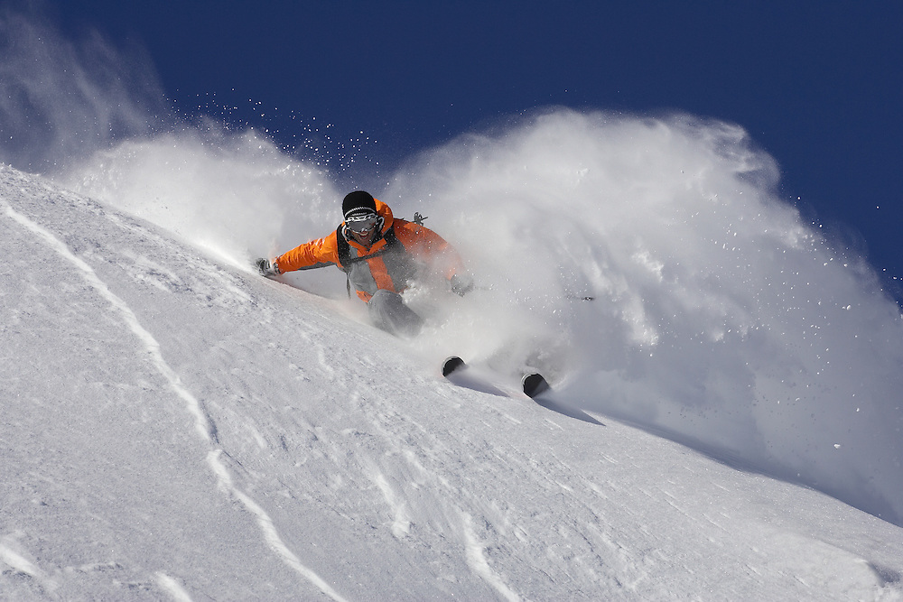 Male skier turning in fresh powder snow, Serre Chevalier, France
