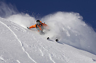 Male skier turning in fresh powder snow, Serre Chevalier, France