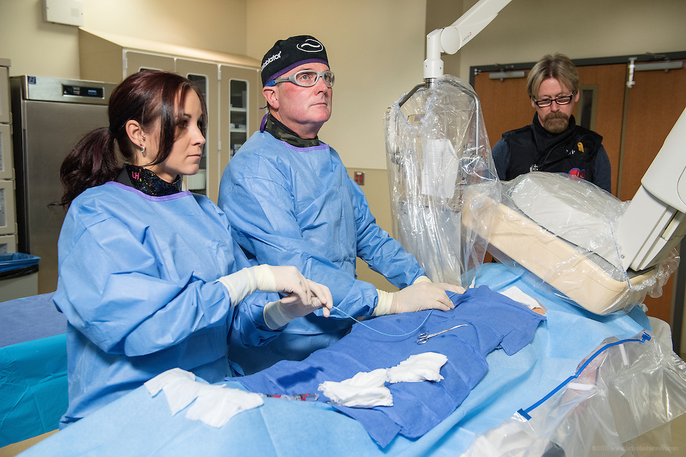 Cardiologist J. Kenneth Ford, MD, photographed performing a procedure with Jamie Hill and Chris Carnes, RN, Tuesday, May 12, 2015 at Baptist Health in Paducah, Ky. (Photo by Brian Bohannon/Videobred for Baptist Health)