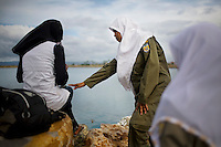A Sharia police officer, or the morality police, lectures to a young woman about her tight-fitting clothes, in Ulele, just outside of Banda Aceh, on Wednesday, Nov. 11, 2009. Banda Aceh enforces a moderate form of Islamic Law.