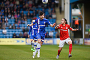 Gillingham defender Aaron Morris and Coventry midfielder Jodi Jones fight for the ball during the Sky Bet League 1 match between Gillingham and Coventry City at the MEMS Priestfield Stadium, Gillingham, England on 2 April 2016. Photo by David Charbit.
