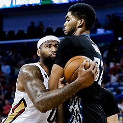 Mar 19, 2017; New Orleans, LA, USA; New Orleans Pelicans forward DeMarcus Cousins (0) collides with Minnesota Timberwolves center Karl-Anthony Towns (32) during the second half of a game at the Smoothie King Center. The Pelicans defeated the Timberwolves 123-109. Mandatory Credit: Derick E. Hingle-USA TODAY Sports