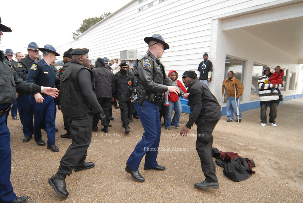 During the protest in Jena Louisana on Martin Lurther King holiday, State police clash with members of the New Black Panthers Party outside the LaSalle County Parish Courthouse Monday Jan. 21,2008.(photo/©SuziAltman) A group of protesters march to Jena High School on the Martin Luther King Jr. holiday in Jena, La., Monday, Jan. 21, 2008. The protest was organized by the self-described 'pro-majority' Nationalist Movement of Learned, Mississippi, lead by Richard Barrett, and was being held in opposition to the six black teenagers who were arrested in the beating of a white classmate in December 2006, and the King holiday. The protest drew about 50 participants and 100 counter-demonstrators to Jena.(Photo/© Suzi Altman).