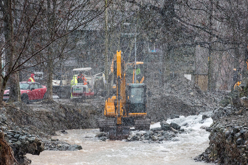 © Licensed to London News Pictures. 11/12/2015. Glenridding UK. The clean up operation in the Village of Glenridding continues today despite heavy overnight rain & hail stones this morning. Photo credit: Andrew McCaren/LNP