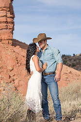 cowboy with a beautiful woman outdoors on a ranch