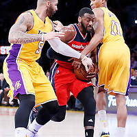 27 January 2015: Washington Wizards guard John Wall (2) drives past Los Angeles Lakers forward Carlos Boozer (5) and Los Angeles Lakers forward Wesley Johnson (11) during the Washington Wizards 98-92 victory over the Los Angeles Lakers, at the Staples Center, Los Angeles, California, USA.